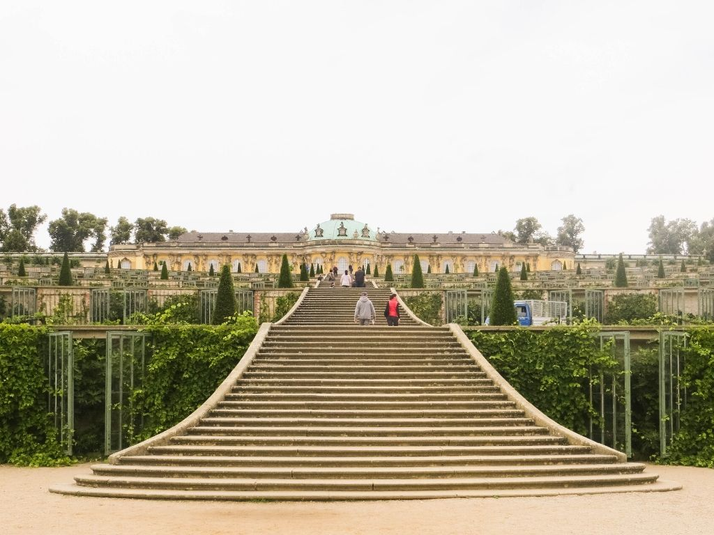 Schloss Sanssouci is an 18th-century palace known for its approach. the palace was a favorite residence of Frederick the Great, the former King of Prussia, who spent many a summer there with his dogs. His grave was actually moved there in 1991, to the highest terrace.