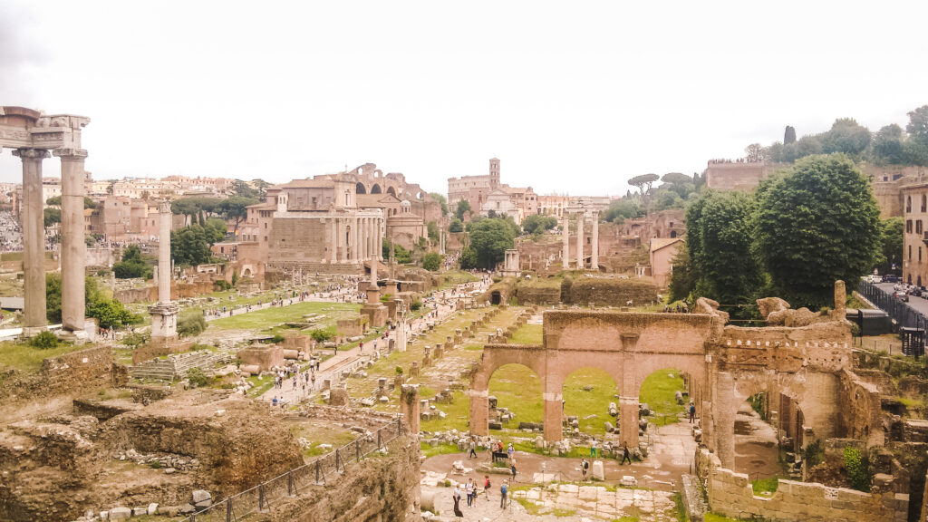 Roman Forum is a rectangular square surrounded by ruins of important government buildings.